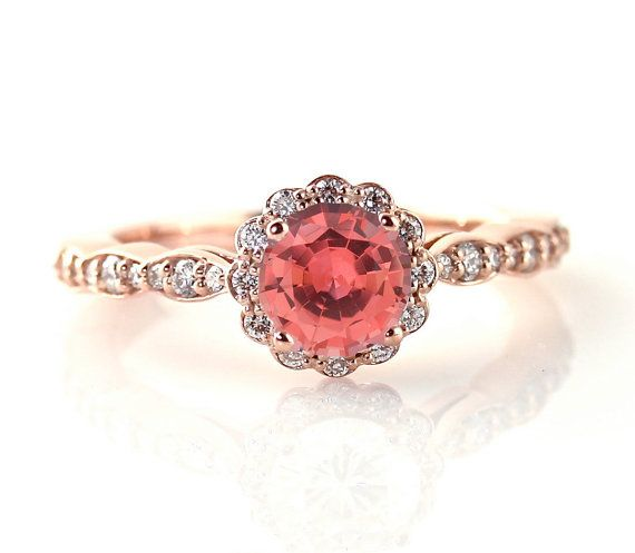 14K Rose Gold Padparadscha Sapphire ring - I like the round stone in the scalloped setting. She has lots of different stones and other types of gold, too.
