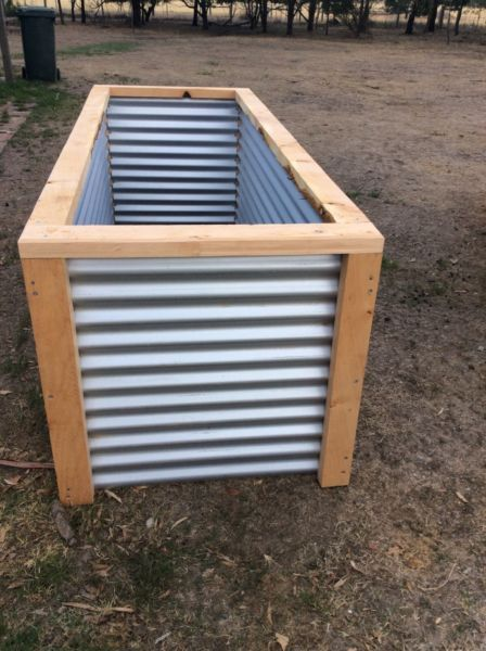 Rustic Gardens Raised Garden Beds Made From Recycled And Reclaimed Materials Corrugated Iron And Cypr Raised Garden Raised Garden Beds Building A Raised Garden
