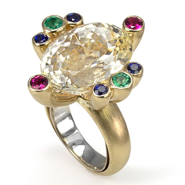 18ct Yellow Gold ring with Kunzites, Sapphires, Tourmalines & Emeralds by Korinna Azreiq. Wow!
