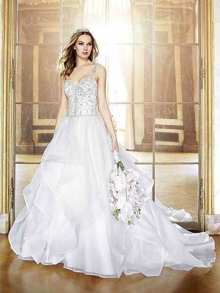 Moonlight Style J6439 This romantic layered organza bridal gown features detailed silver embroidery that adorns bodice and compliments the beaded straps. The organza train with cascades enhances the sexy revealing low back.