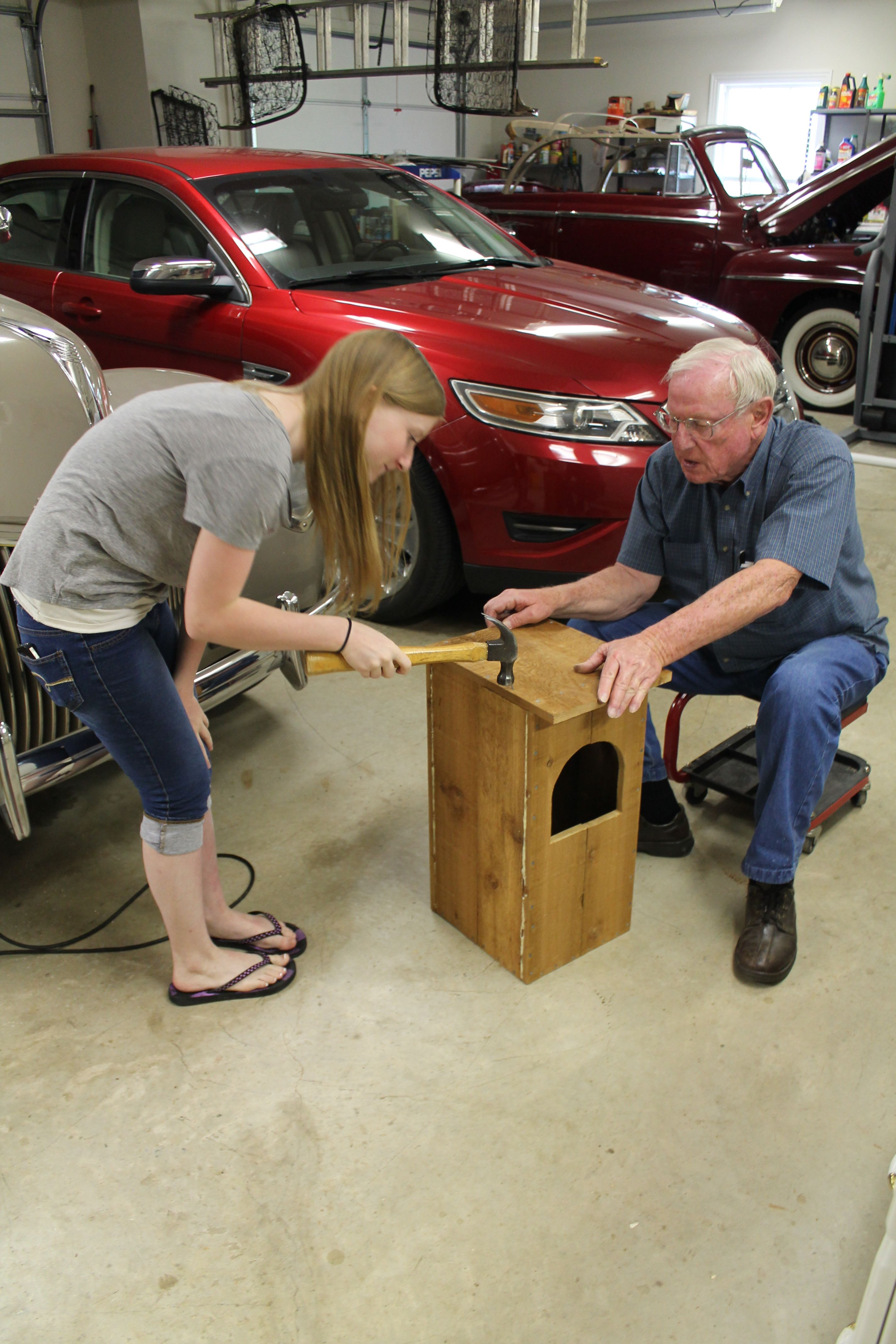 rachel and her grandpa built an owl house for part of her girl scout