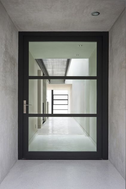 The Glazed Entry Door Becomes A Frame For The Views That Unfold Upon