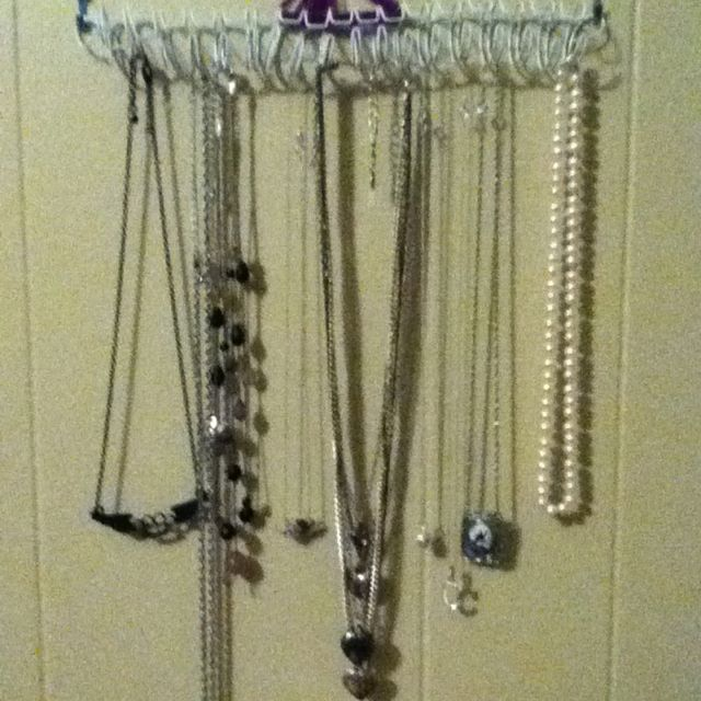 Old notebook binder and some nails equals necklace organizer!