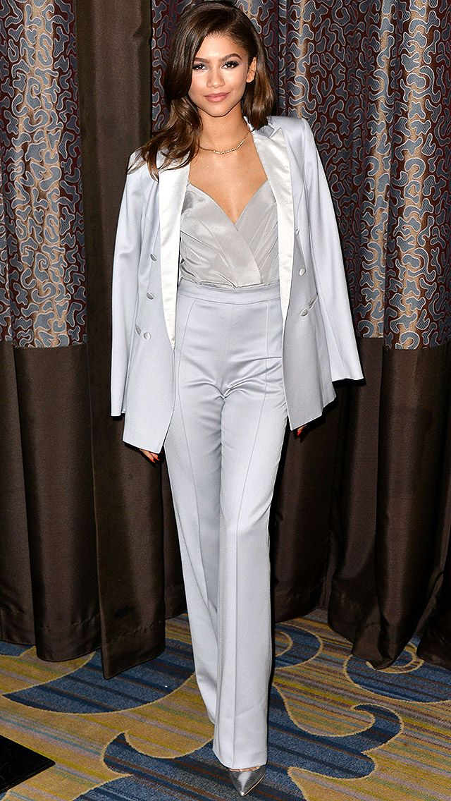 ZENDAYA in a sleek gray three-piece tuxedo-inspired pantsuit by Kayat, which she pairs with metallic pumps, at the Bill of Rights dinner in Beverly Hills.