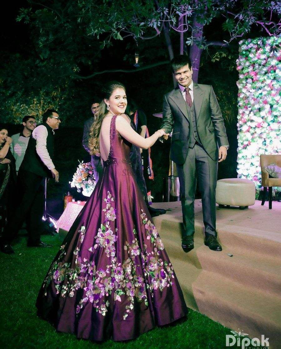 f2a688cac1a This bride looks drop dead gorgeous in that low back satin purple dress  with floral embellishments!  bridetobe  bride  bridallook  reception   rreceptionlook