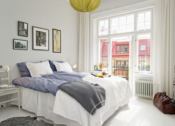 Superior 35 Scandinavian Bedroom Ideas Present Impeccable Interior : Relaxing Bedroom  With A Small Balcony And An Eye Catching Accent Pendant Light