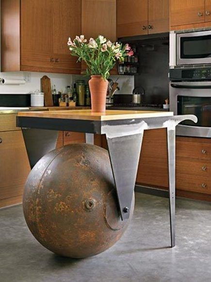 A salvaged marine steel buoy ball is repurposed into a functional