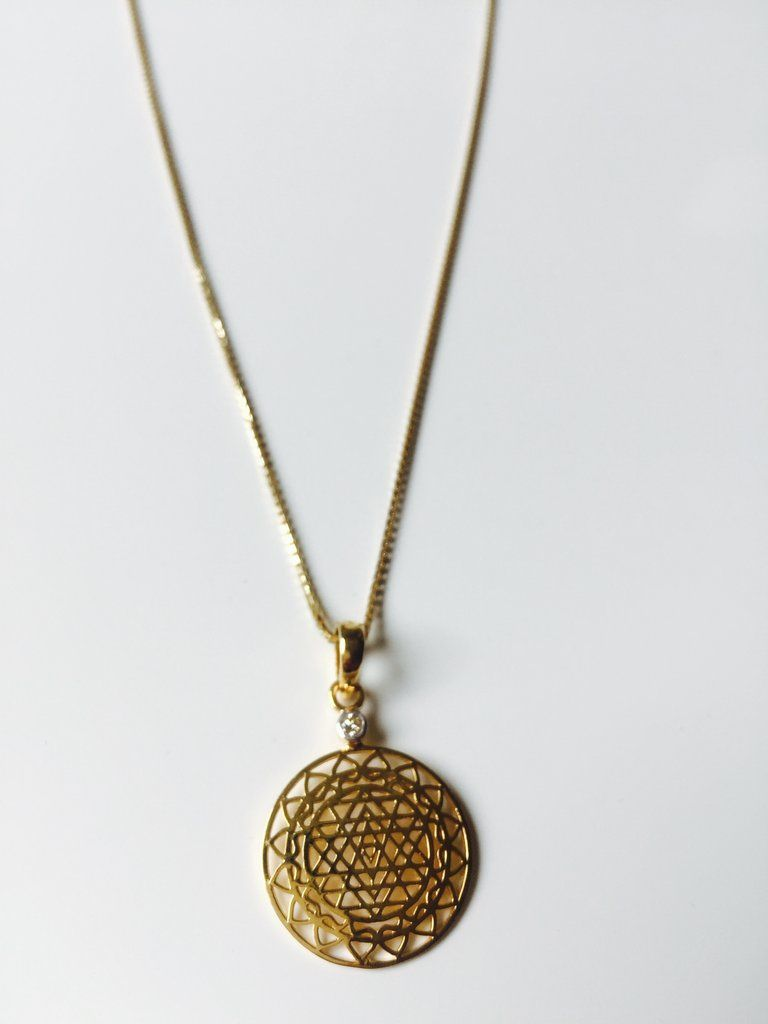 14 karat Gold Sri Yantra Pendant Mounted with Diamond on