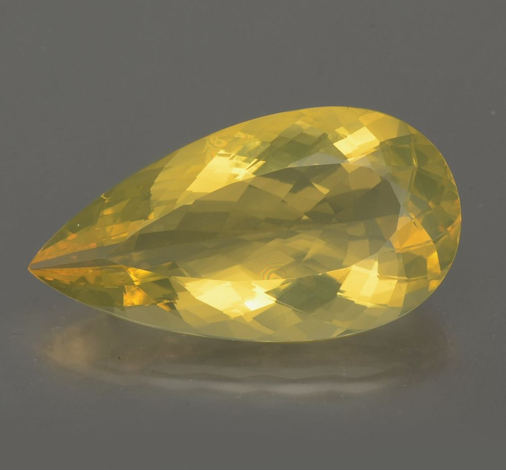 A brightly color yellow fire opal with a light color play to amaze ...