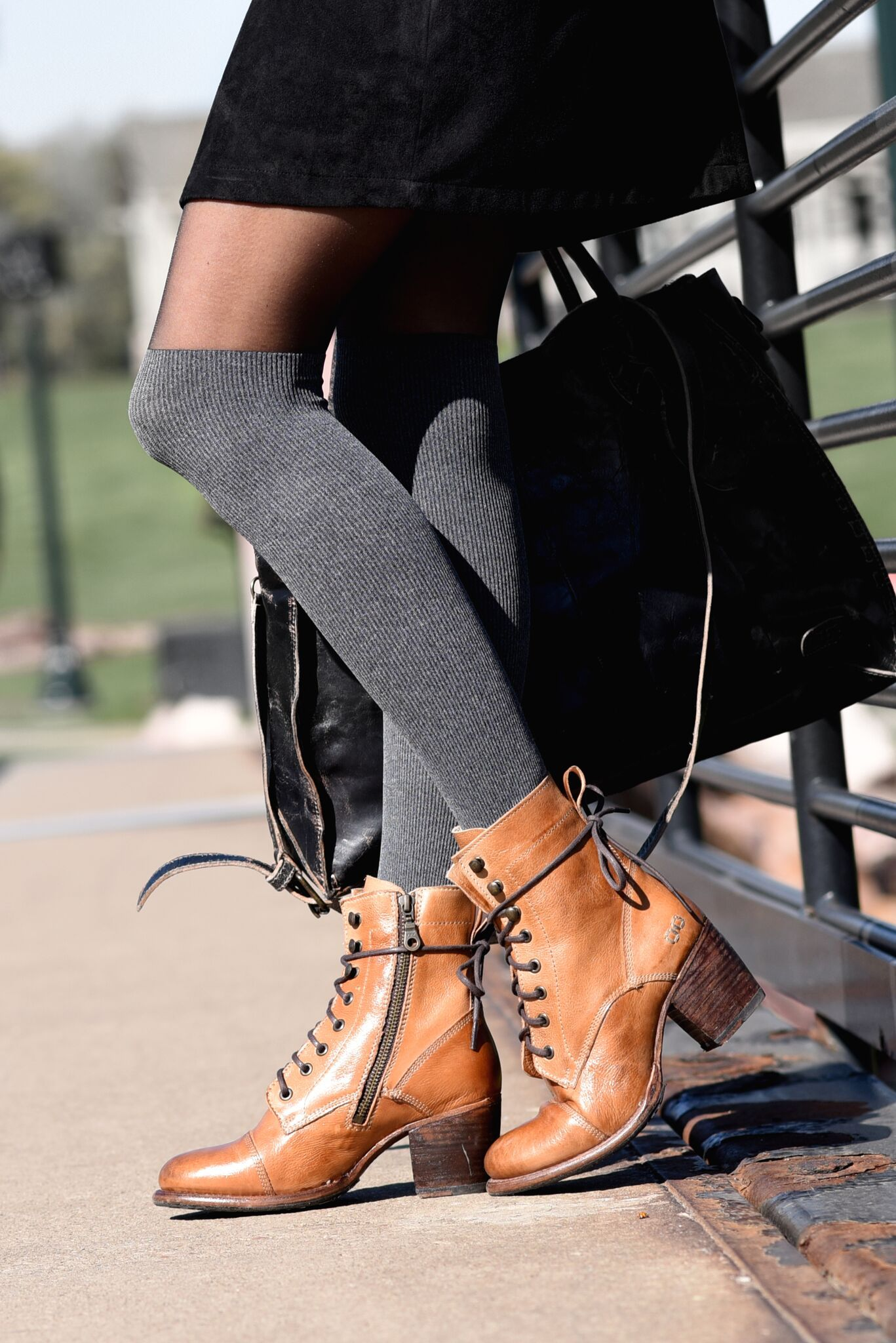 Tan lace up booties by BEDSTU. Style it with long thigh high socks and stay  extra cozy. fc9ccda063ff