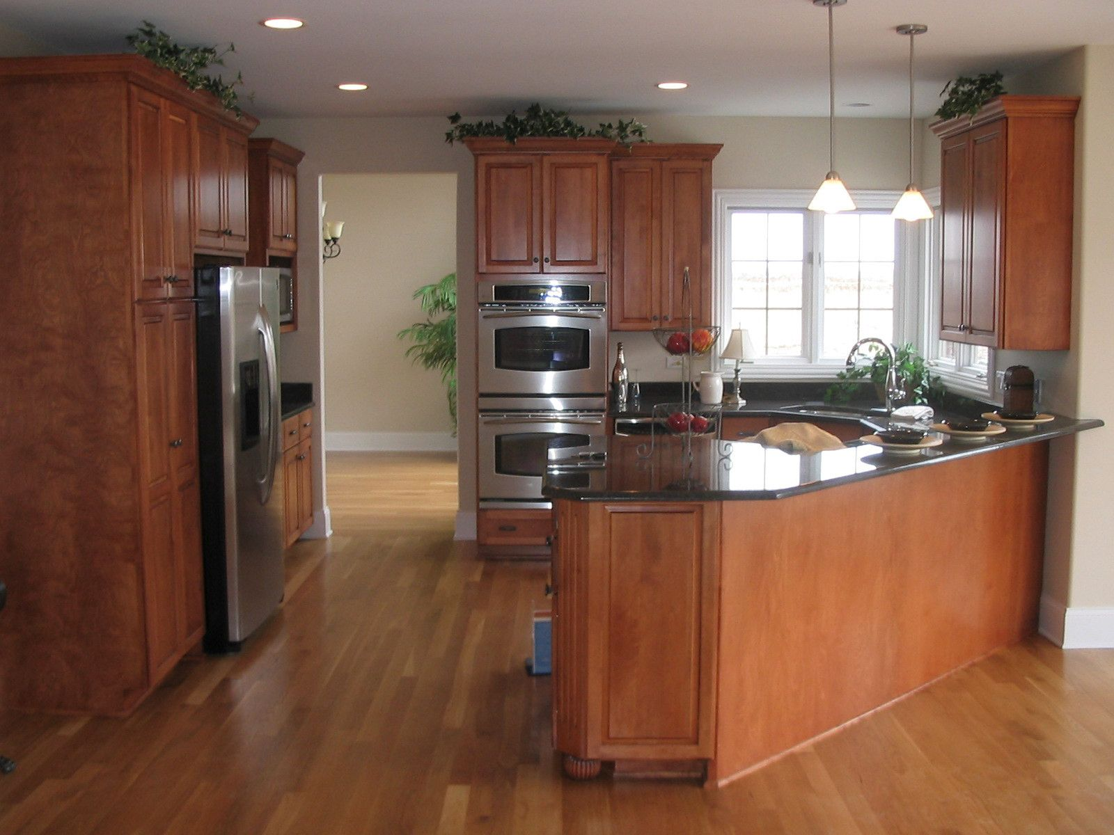 Wood Cabinets With Black Granite Counter Tops Angled