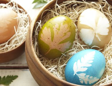 Lay the leaves of herbs like cilantro or mint against your egg, then wrap the egg in pantyhose to keep the leaves in place. Dip in dye, allow to dry, and reveal a color-blocked creation.