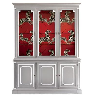 Mod China Cabinet | A pale gray lacquer (Dovetail; sherwin-williams.com), paired with crisp white trim and a graphic papered interior (Zebras; scalamandre.com), wakes up a faded but handsomely proportioned cabinet. | SouthernLiving.com