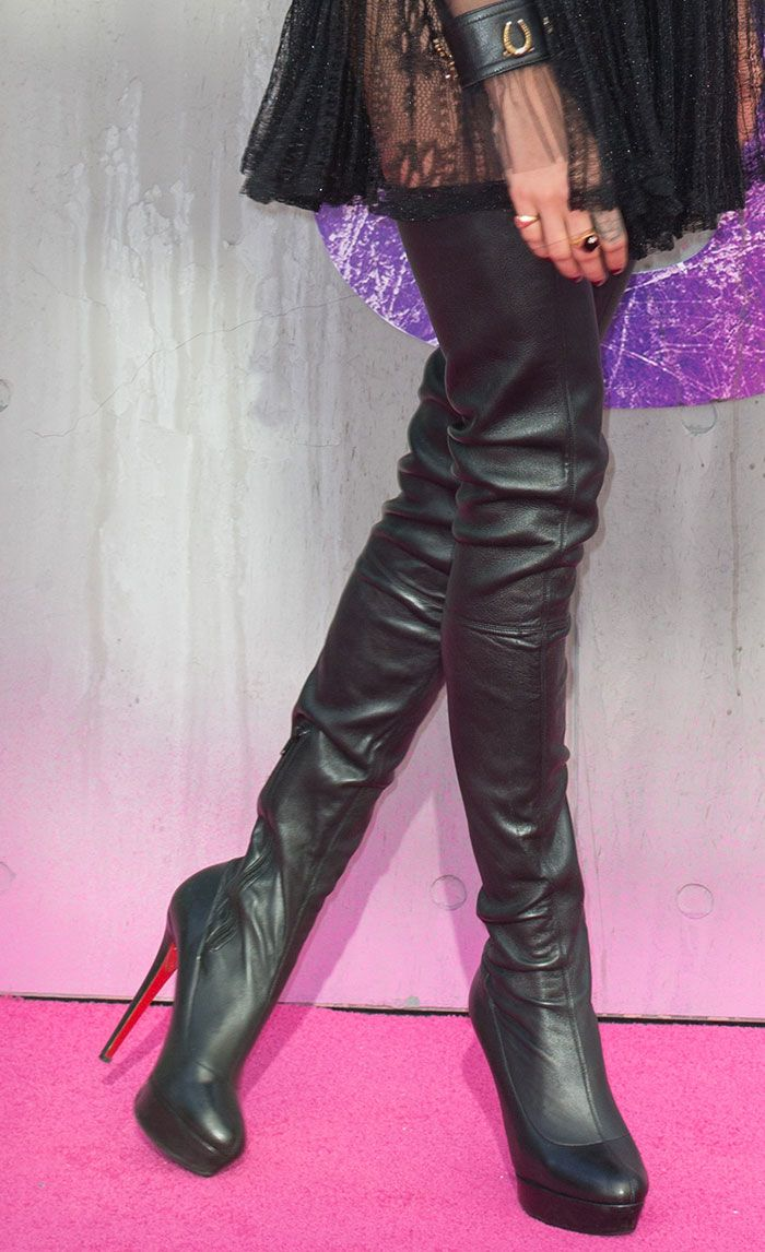 4c3ab20ace0 Cara Delevingne in Christian Louboutin thigh-high boots