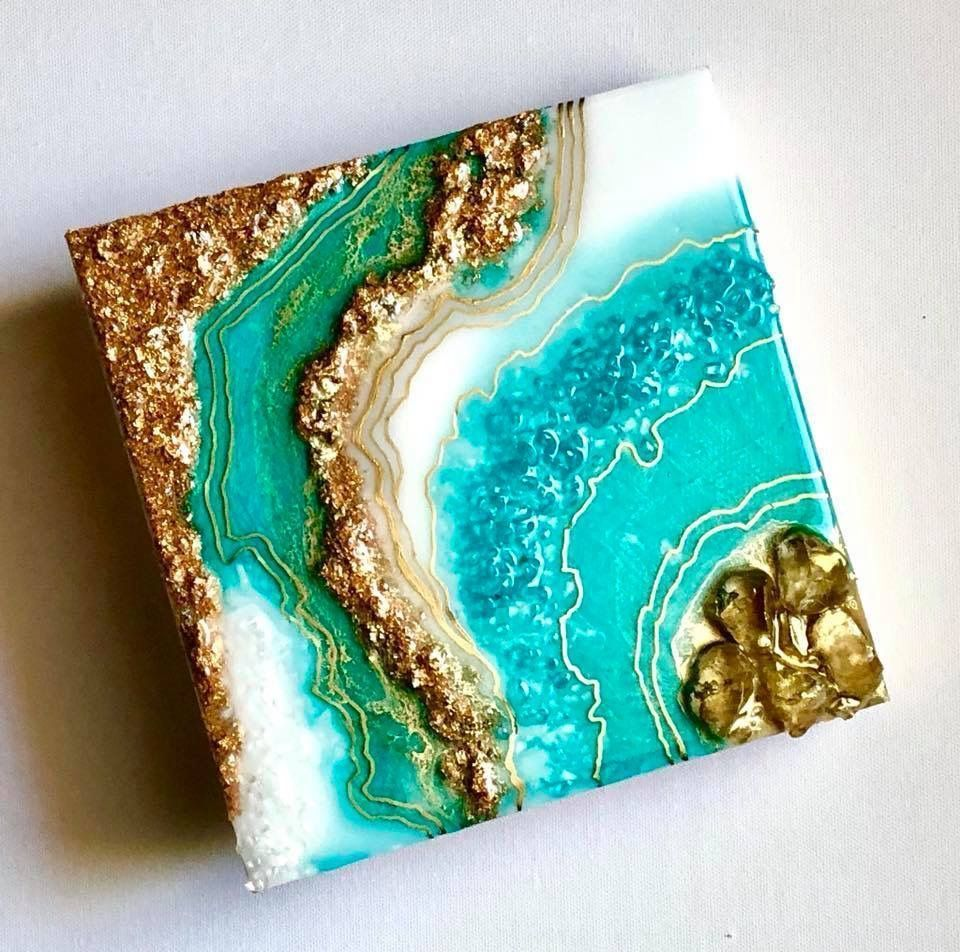 Geode wall art sparkles with glitter and real crystals