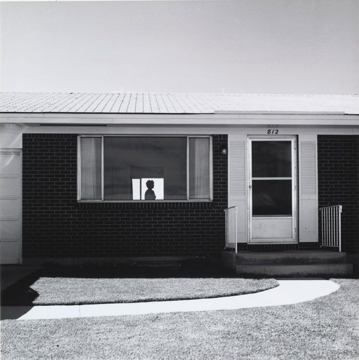 I love the framing. The bleakness of the suburban landscape ...