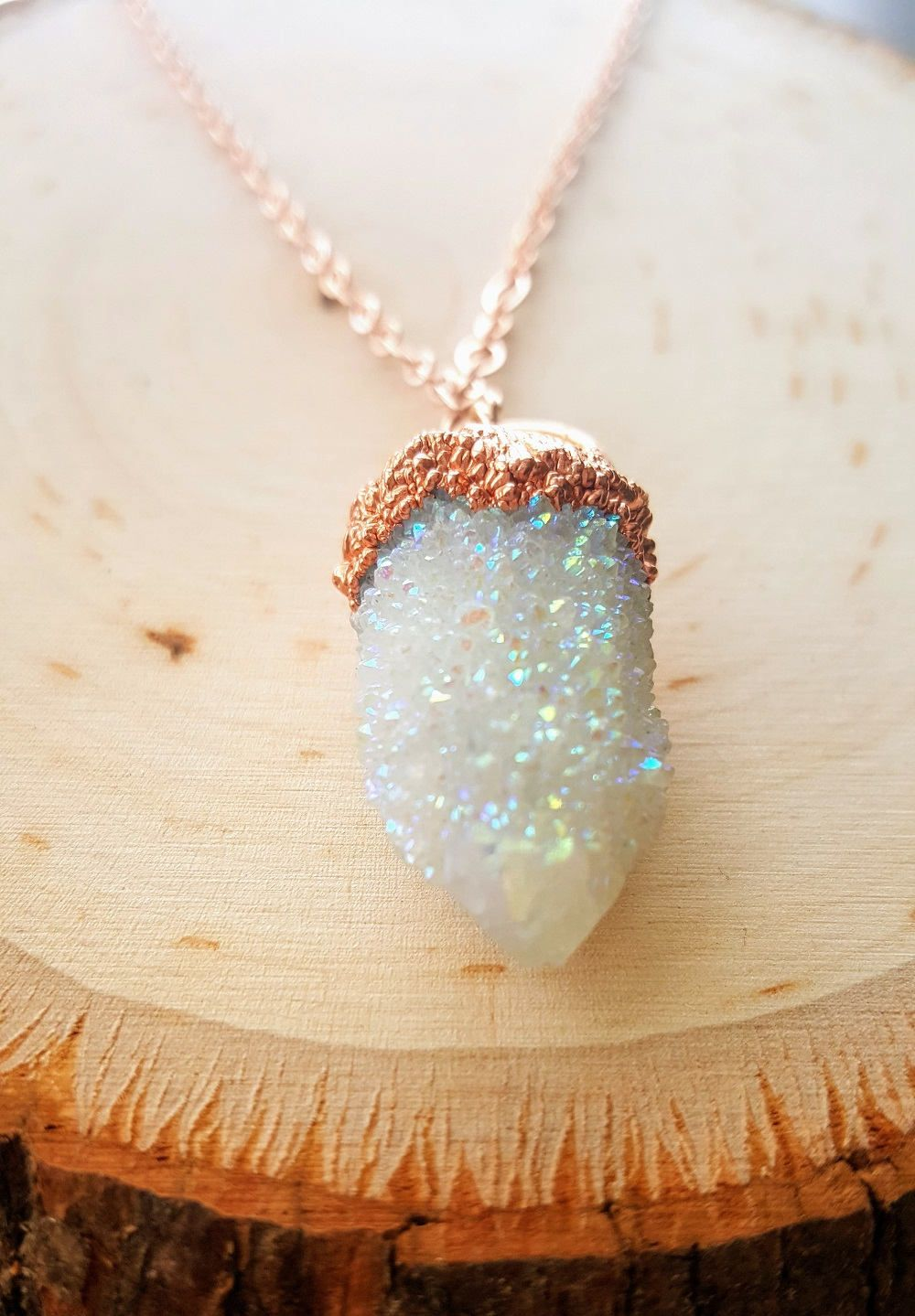 Angel Aura Quartz heart pendant in antique copper wire