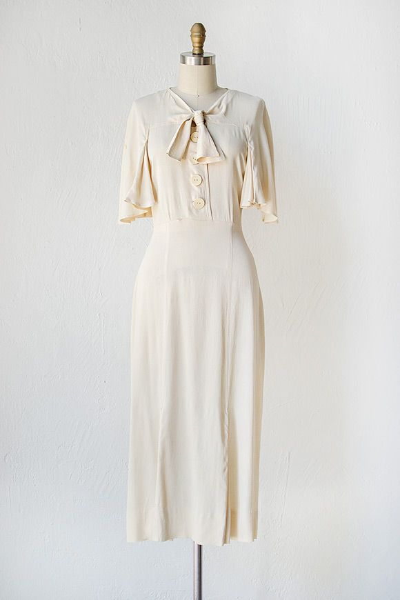 1930's dress made from an ivory silk rayon features a v-neckline ...