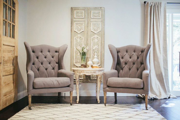 French Living Room Design Amusing French Sitting Room Features A Pair Of Gray Tufted Wingback Chairs Inspiration Design
