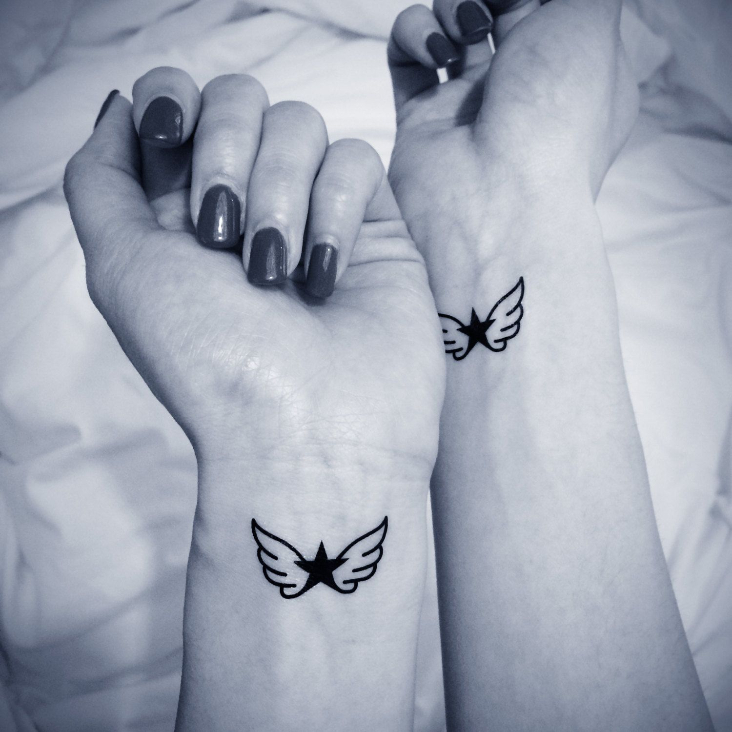 Wing tattoos on wrist by Bonnie Yaeger on First Tattoo