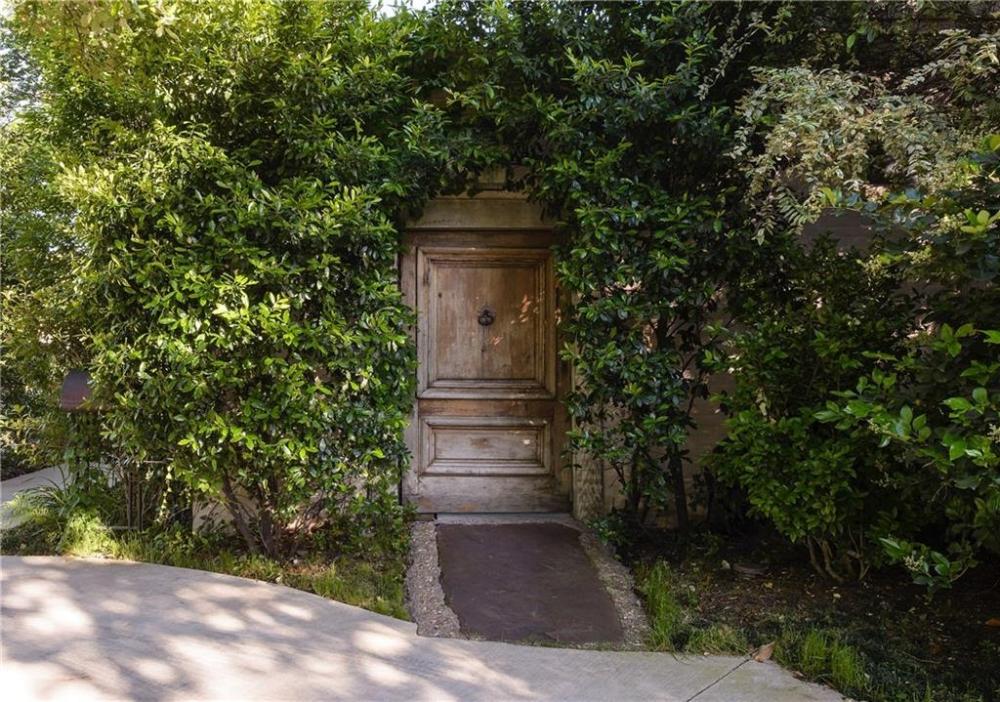 COTE DE TEXAS: EAST & ORIENT, Betty Gertz and Axel Vervoordt  The antique front door, off the new circular drive, that leads to the first courtyard. #walkwaystofrontdoor