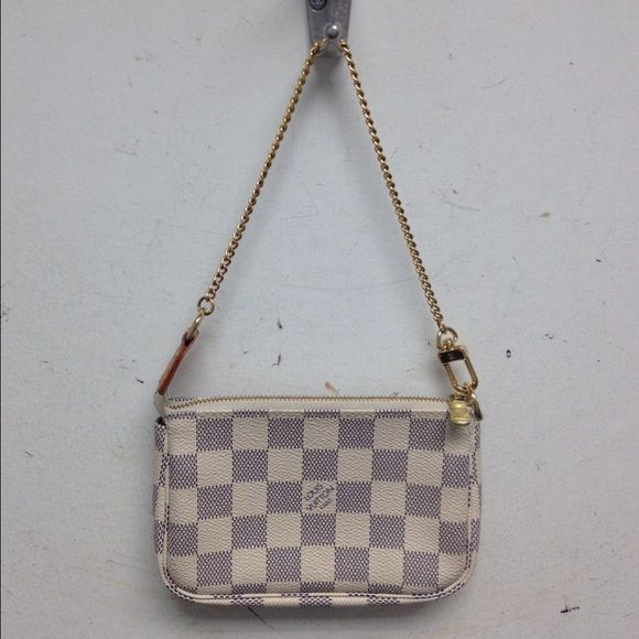 Louis Vuitton Damier Azur baguette. This cute little bag has some color transfer from my jeans as seen in the picture. Clean inside and a perfect size. Louis Vuitton Bags Mini Bags