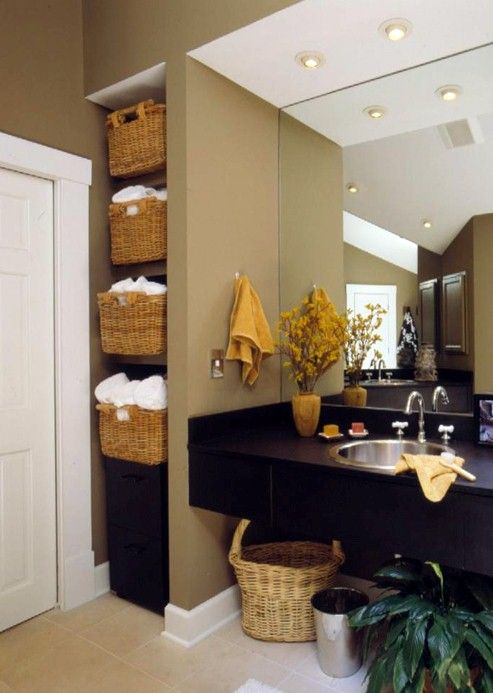 I LOVE the baskets on the shelves in this bathroom!  They add a great natural texture!