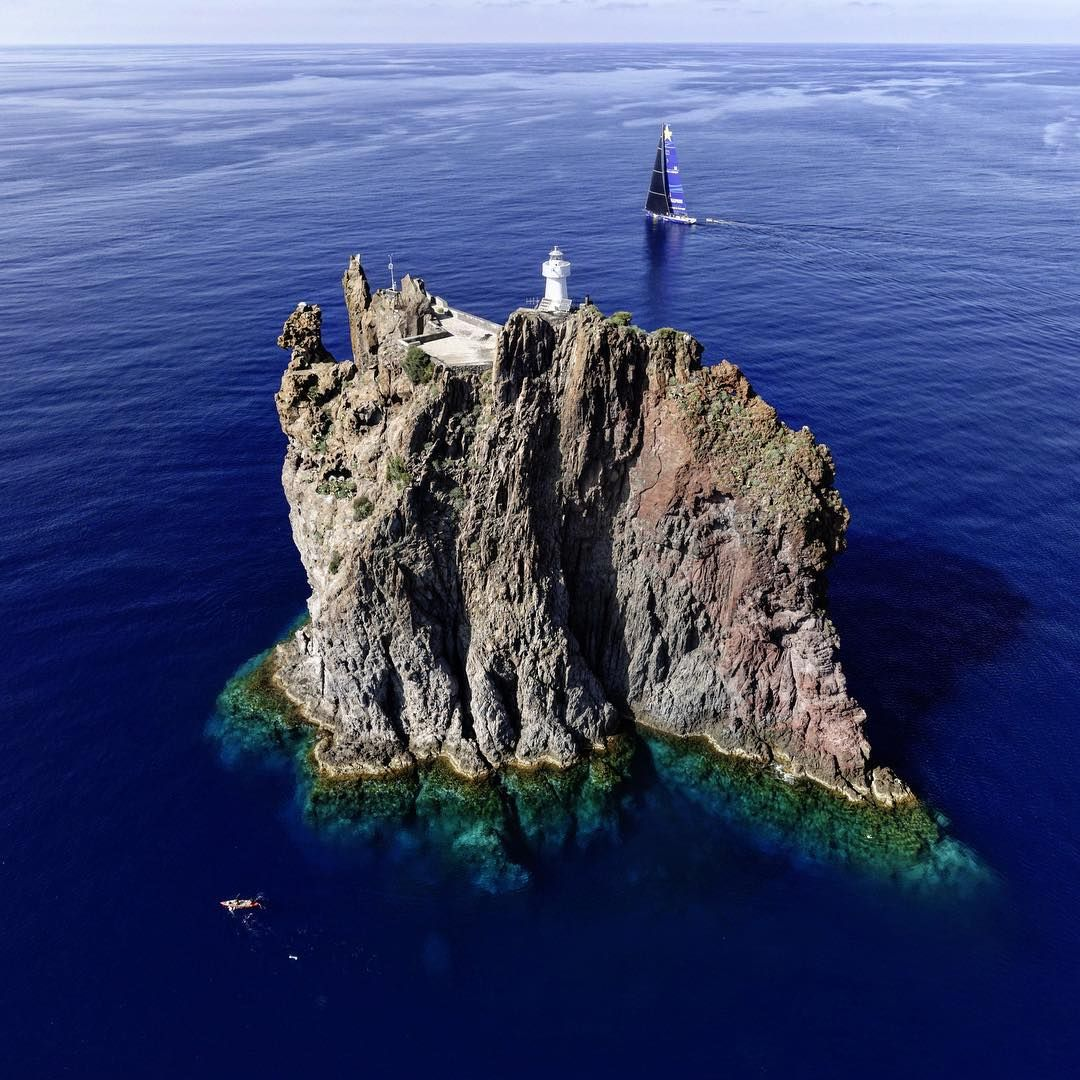 "Kurt Arrigo: ""Strombolicchio - the remains of a Volcano that eroded some 200,000 years ago. Now an iconic landmark during the #rolex middle sea race."""