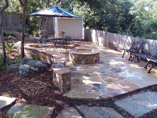 Outdoor #stone work for #backyard with stone #fireplace by ...