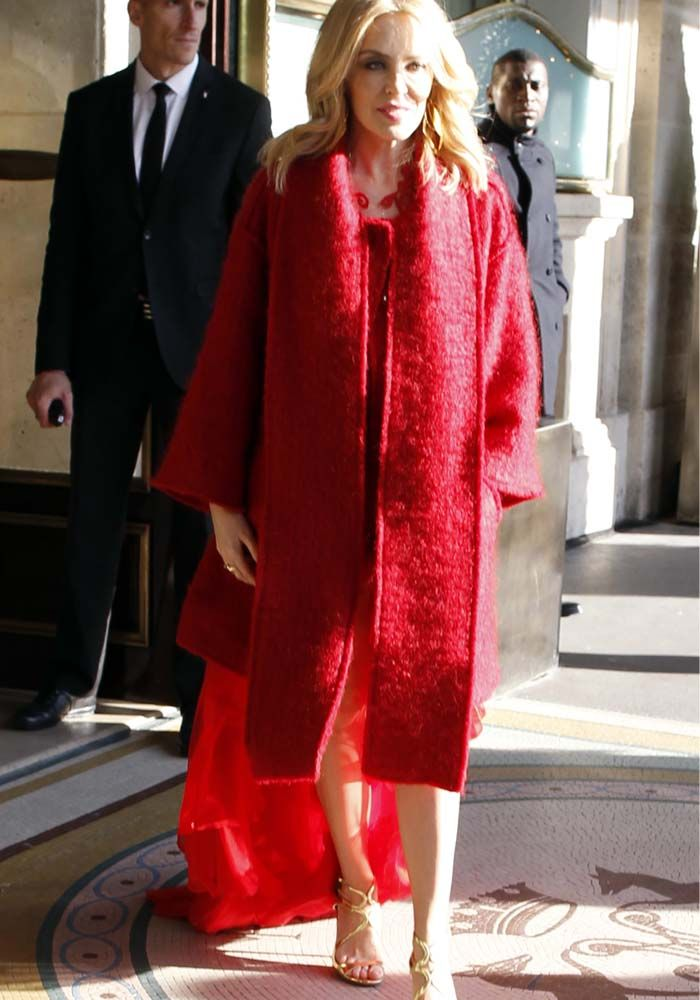 """2da1244946e Kylie Minogue Is a Vision in Red as She Leaves Paris Hotel in Gold Jimmy  Choo """"Lang"""" Heels"""
