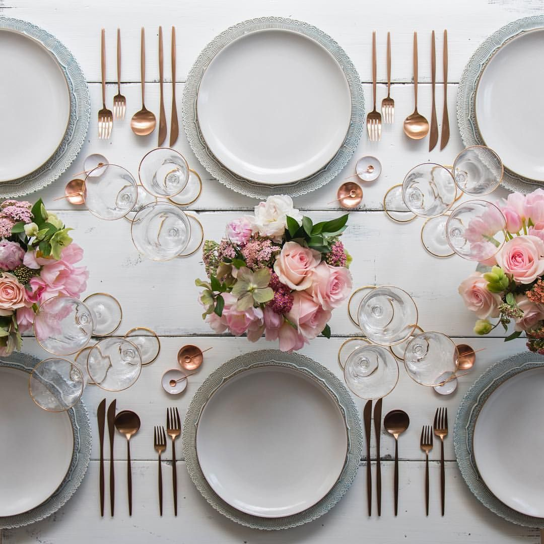 Setting up for a beautiful Mother's Day weekend. Happy happy to all the amazing mamas out there!!  With our Dusty Blue Lace Chargers + Heath Ceramics in Opaque White + Moon Flatware in Rose Gold + 24k Gold Rimmed Stemware + White Enamel/Copper Salt Cellars + Tiny Copper Spoons #cdp3x3 # #kuchentisch