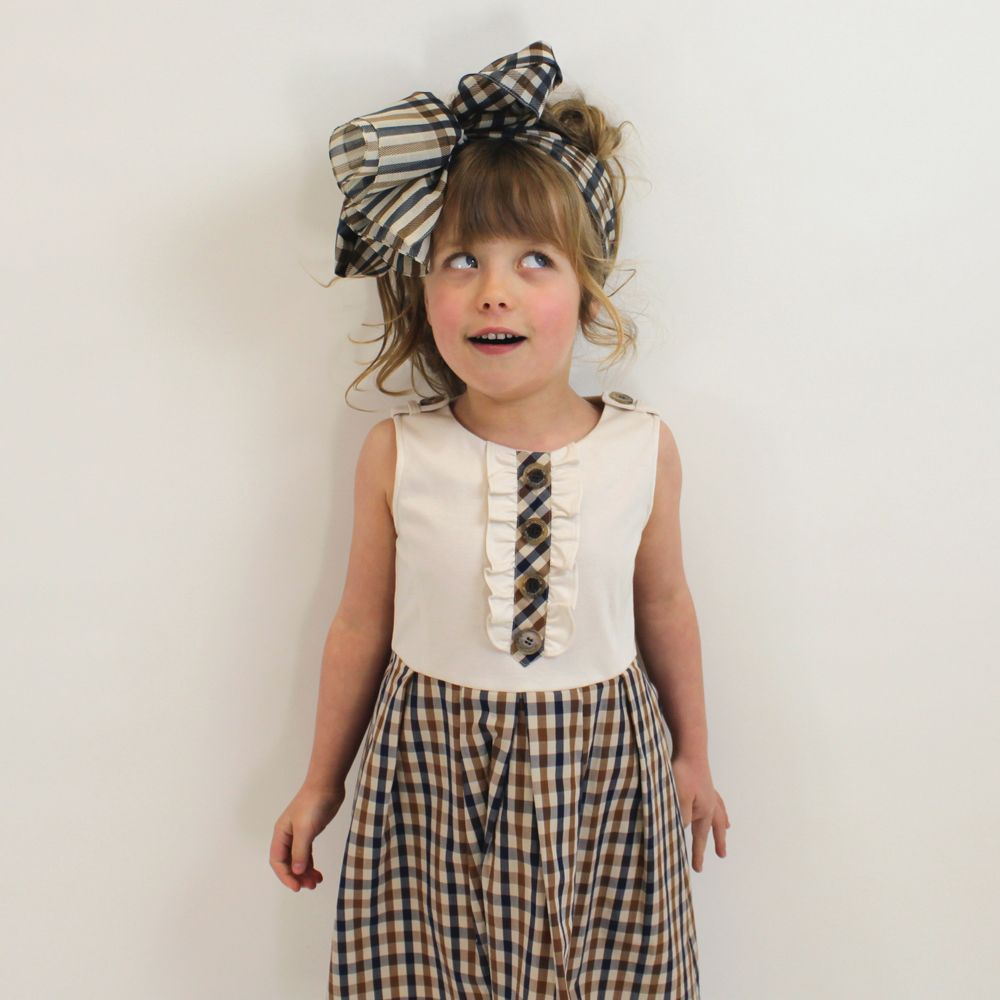 Aoife in Aquascutum dress & scarf at Designerchildrens... #aquascutum #designerkids #designerclothes #luxurykids #kidsclothes #girlsclothes #harperbeckham #suricruise #dress #headscarf