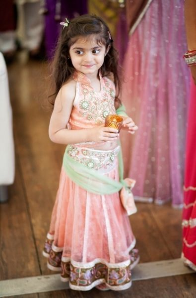 f37541ff4b03 Beautiful Indian kid in a traditional outfit. Lehenga for Baby girls Indian  Dresses ...