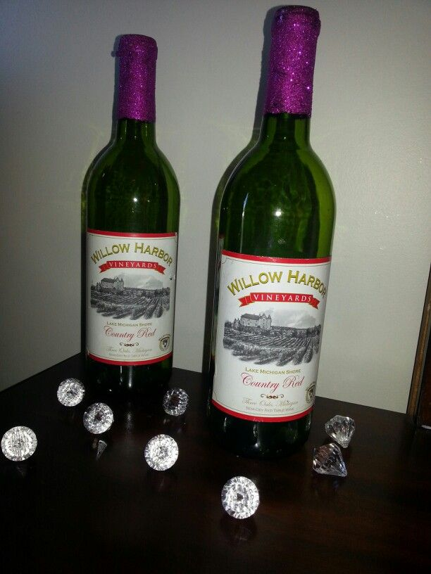 My first successful diy! Mod podged purple glitter (wedding color) onto the top of the wine bottles from my wedding. :)