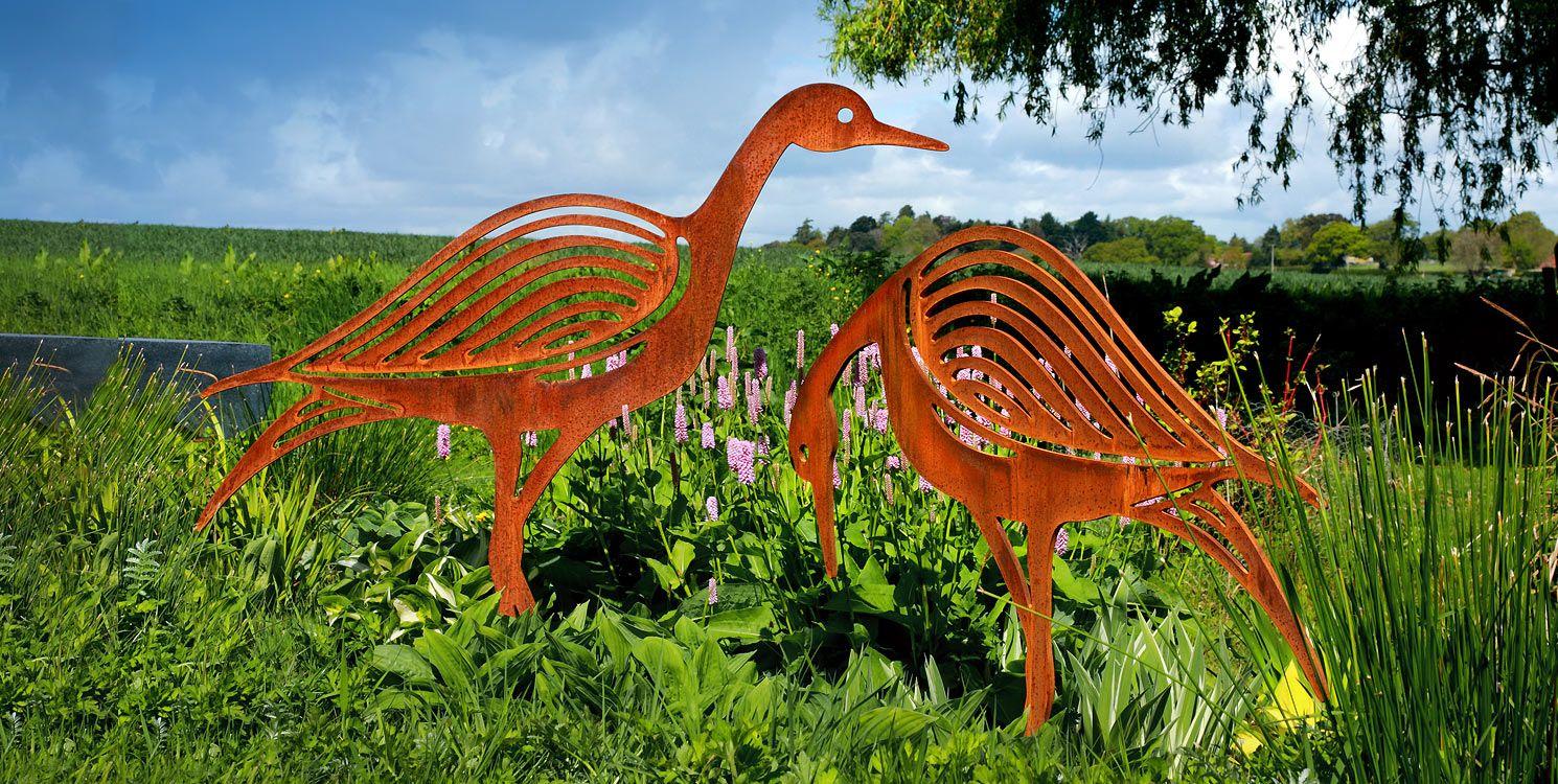 A pair of sandpiper sculptures metal bird garden