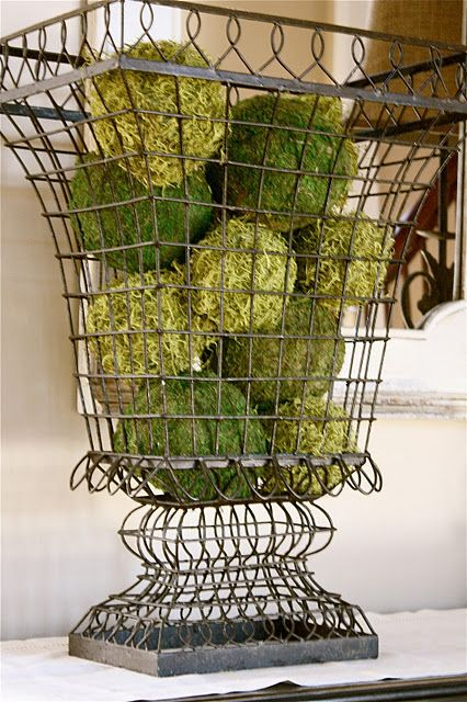 wire urn filled with moss balls