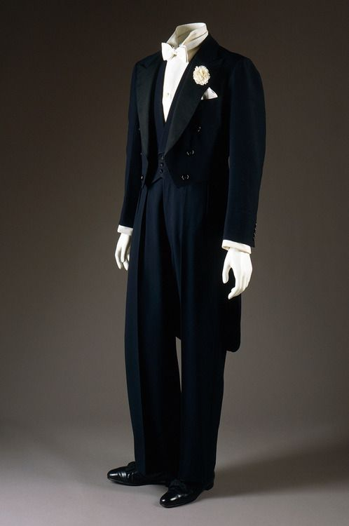 """Midnight blue evening tailcoat and dress vest by Frederick Scholte for the Duke of Windsor, 1938. Trousers by H. Harris, New York, 1965, as a copy to replace the 1938 original. The Duke always had his trousers made separately in America because Scholte (father of the famed """"draped cut"""" later adopted by A) refused to cut them as baggy as he liked. I'm with Scholte."""