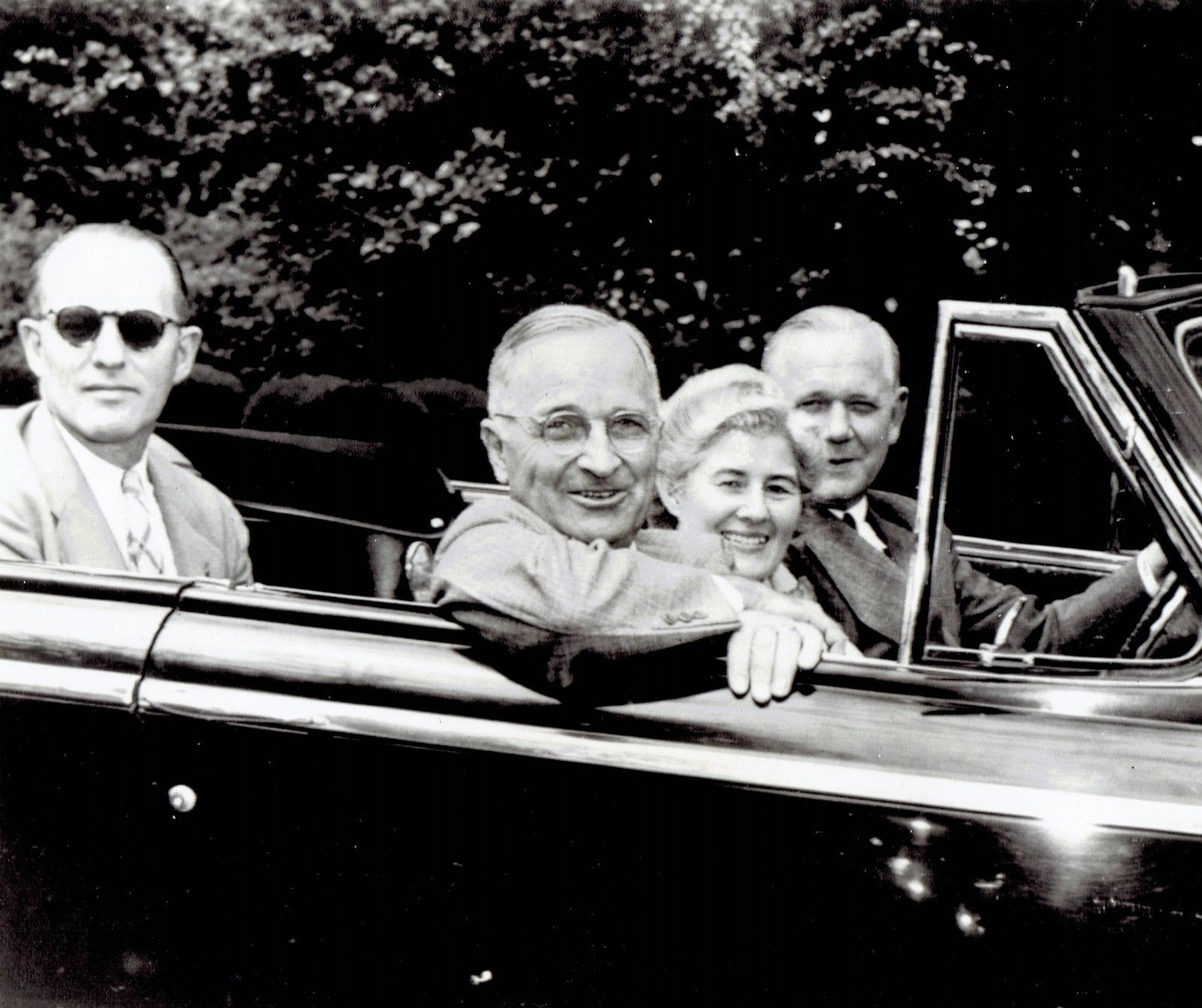 President Truman with Secret Service agent riding in back