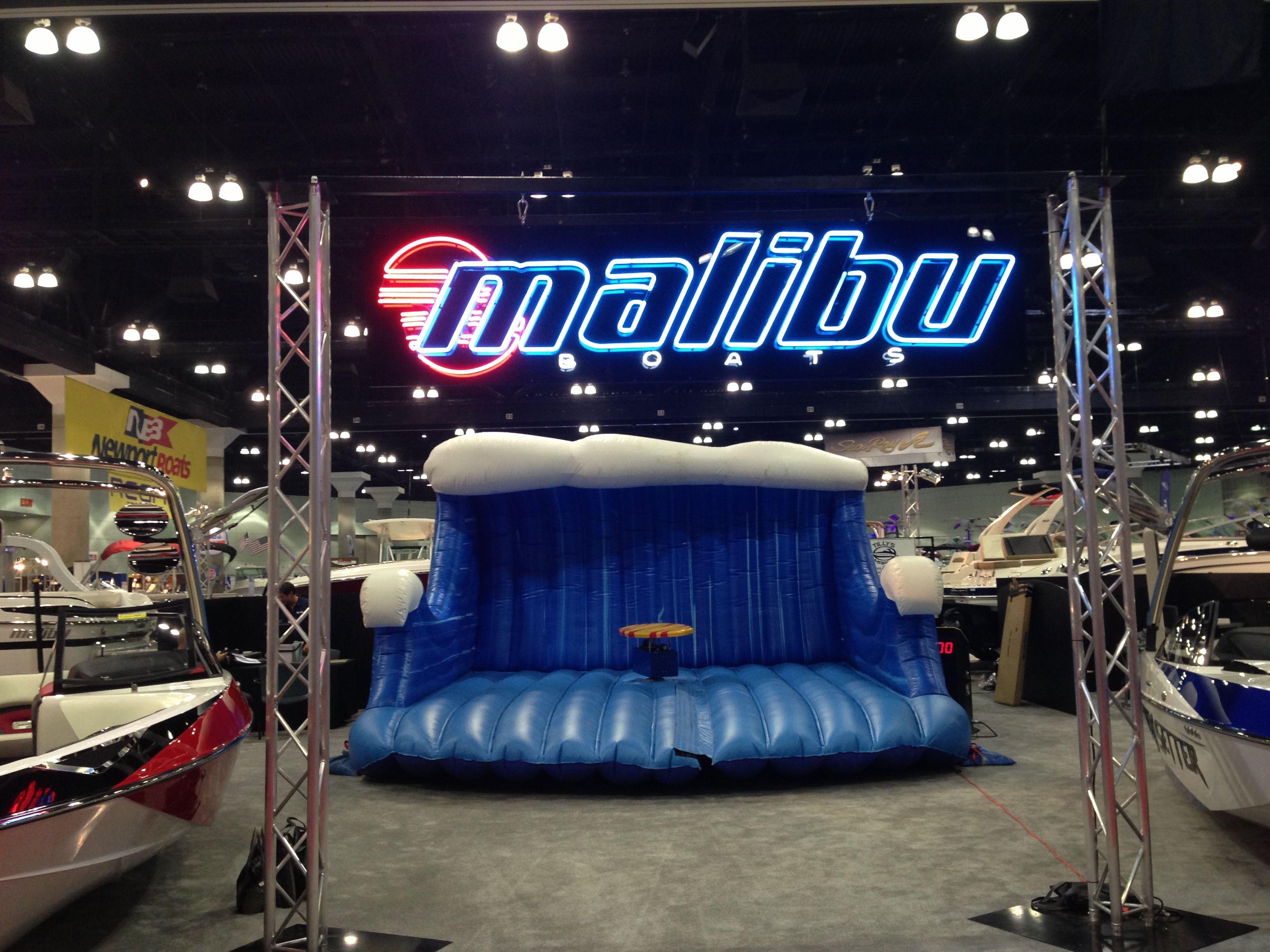 Mechanical rides mechanical bull surfboard simulator