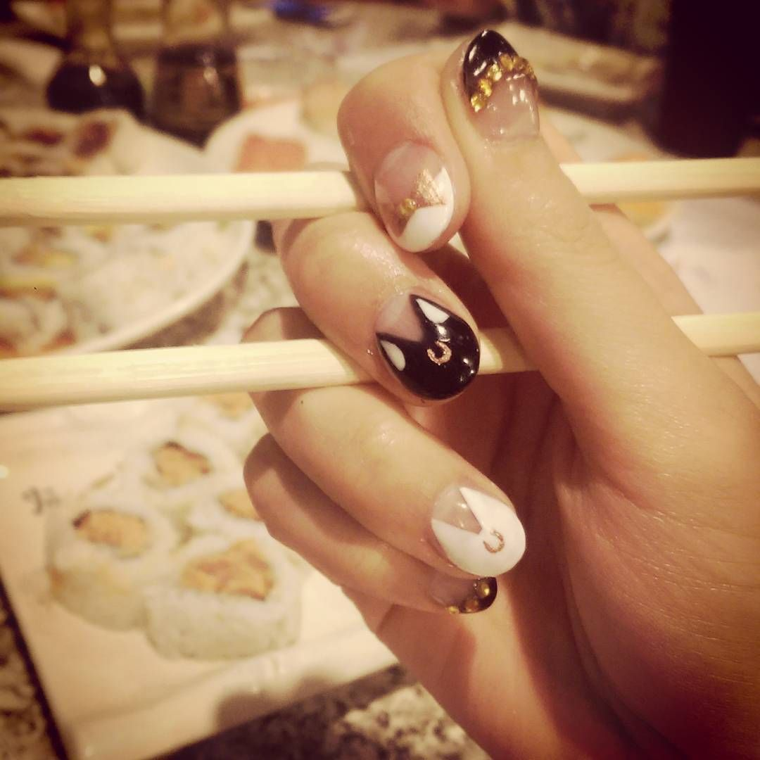 Eating sushi with Sailor Moon nails! The Asian is strong in me today ...