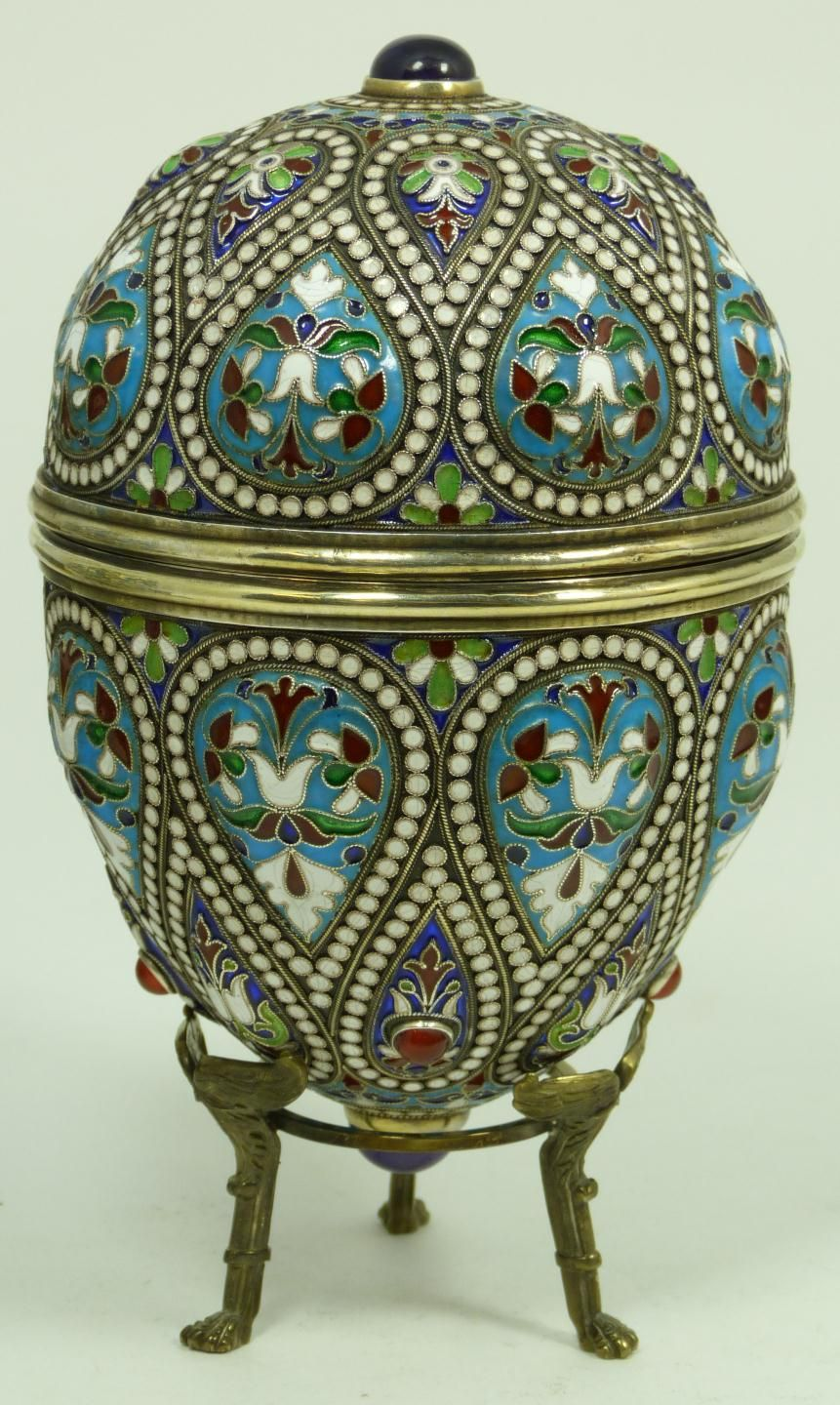 Russian silver egg with multicolor enameled raised tear drop design throughout. Jeweled with round Cabochon amethyst stones on each end.