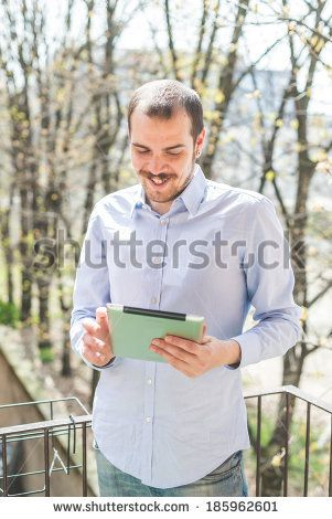 elegant business multitasking multimedia man using devices at home - stock photo BUY IT FROM $1 ON SHUTTERSTOCK