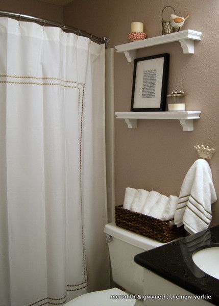 Small But Lovely Beige Bathroom With White Shower Curtain And Curved Shower  Rod.