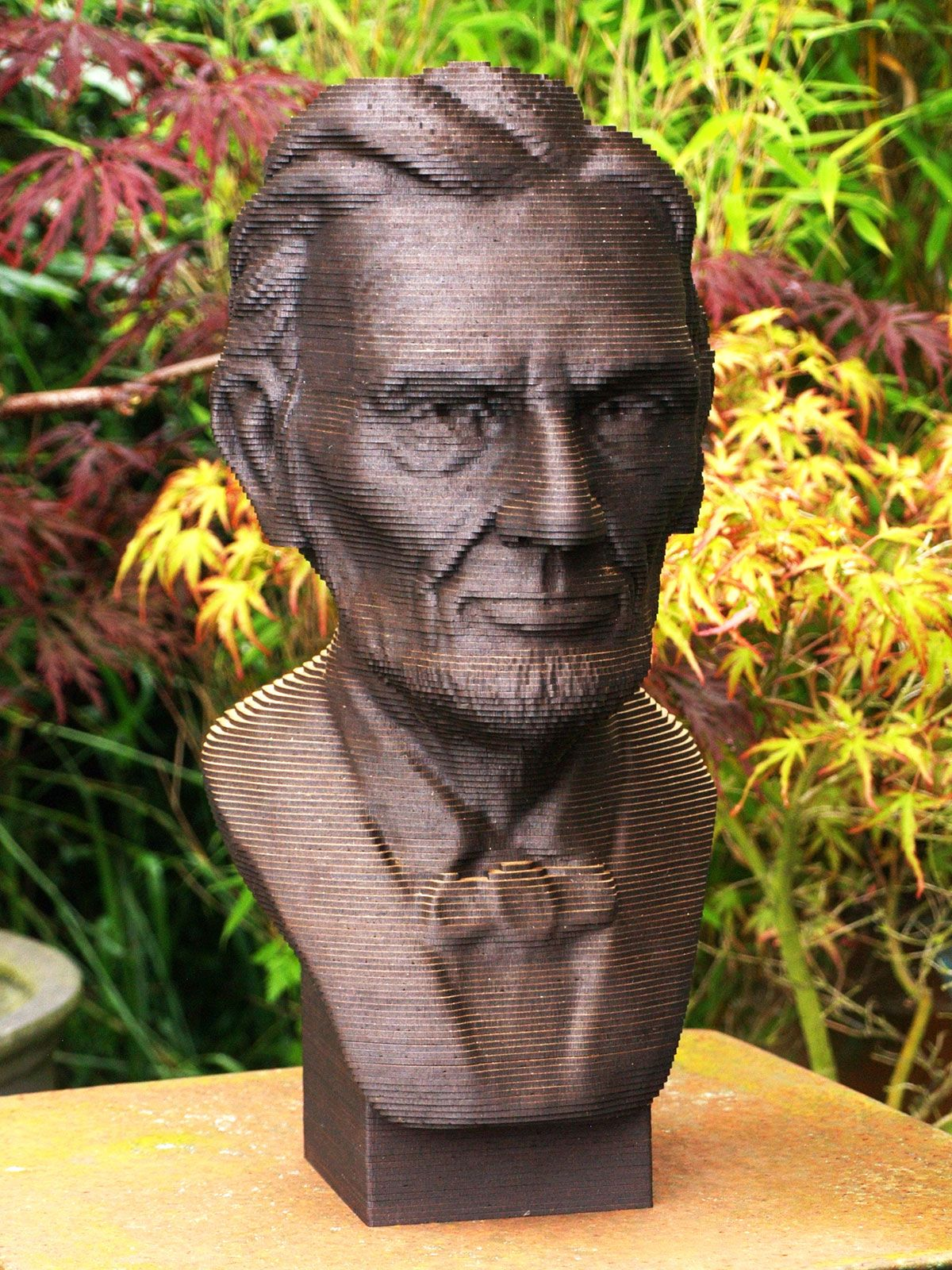 Although Abe is made of almost 200 slices of 2mm laser-cut wood, it almost looks as though he's made of bronze ...