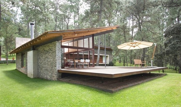 Mexican architecture firm Elias Rizo Arquitectos designed this 3,445 square foot contemporary home back in 2008. It's located in a secluded forrest in Tapalpa, Mexico.
