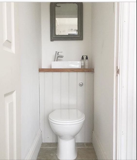 Some bathroom fixtures are made specifically with cloakrooms and small bathrooms in mind. Opt for a small cloakroom counter top basin and place just above your toilet's concealed cistern to make the most of your space.   #bathrooms #bathroomidea #bathroomdecor #bathroomdecorideas #bathroominspiration #bathroomdesign #cloakroom #smallbathroomdesign #smalltoiletroom