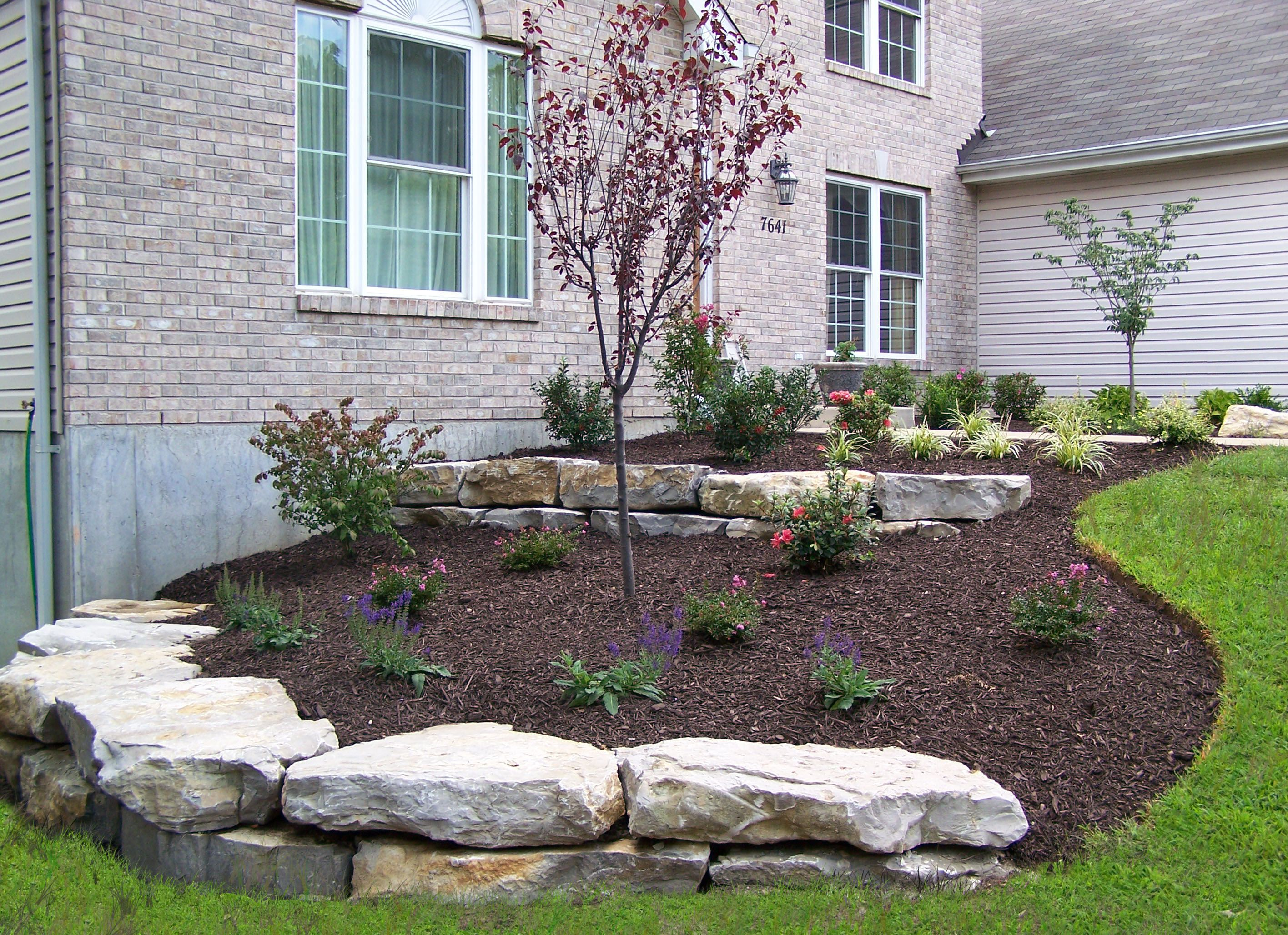 Landscaping boulder walls boulder retaining walls for Large lot landscaping ideas
