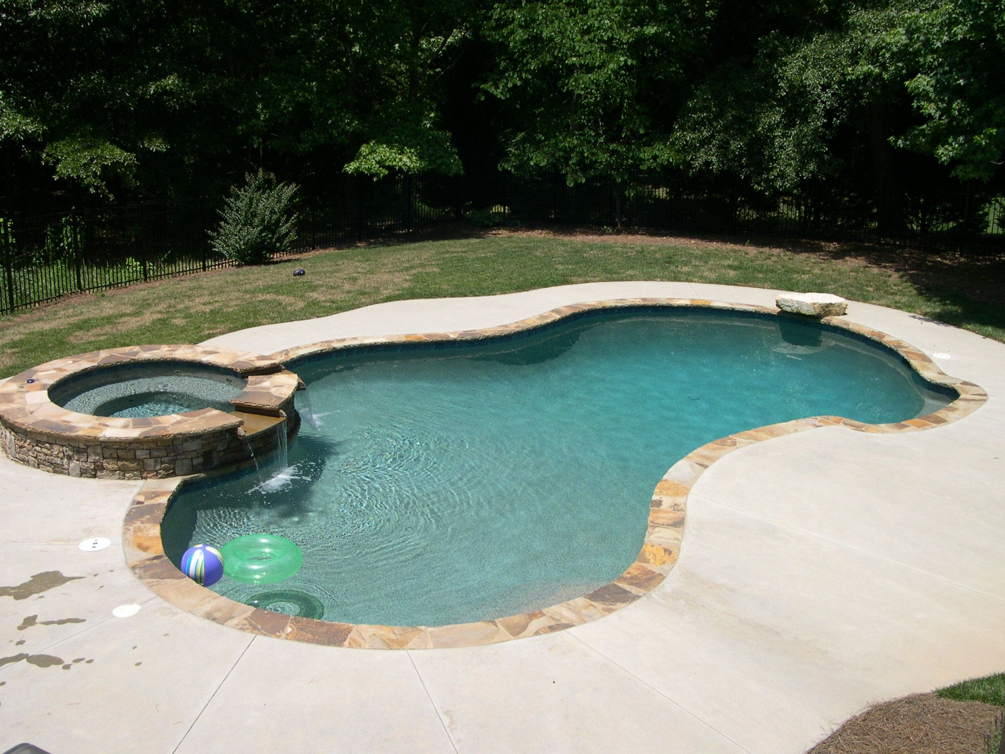 Gorgeous Shapeless Small Inground Pools With Jacuzzi As Well As Green Grass Fields As Decorate Inground Pool Designs Pools For Small Yards Small Inground Pool