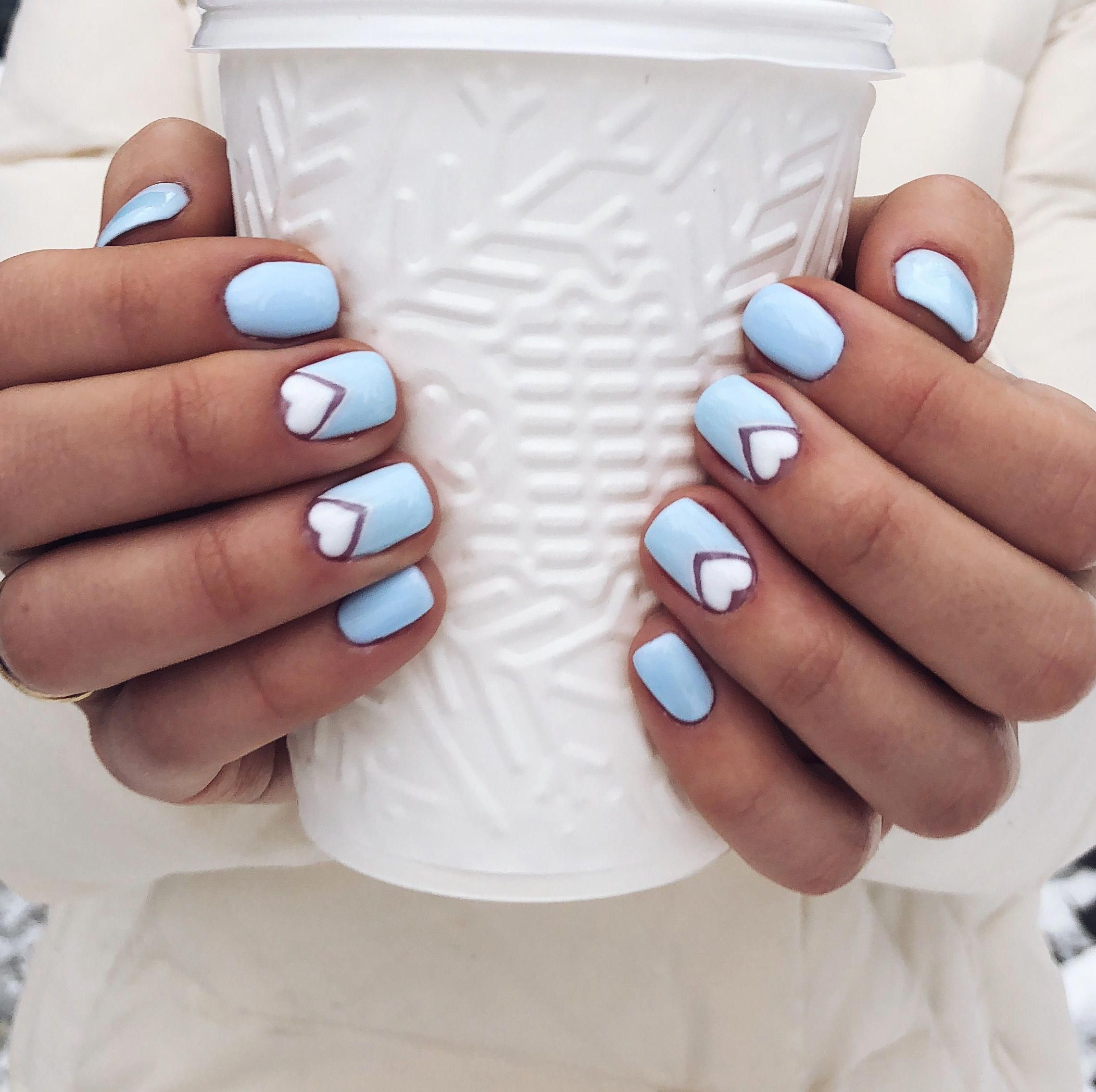 Ideas for winter nails. Light blue with white hearts nail