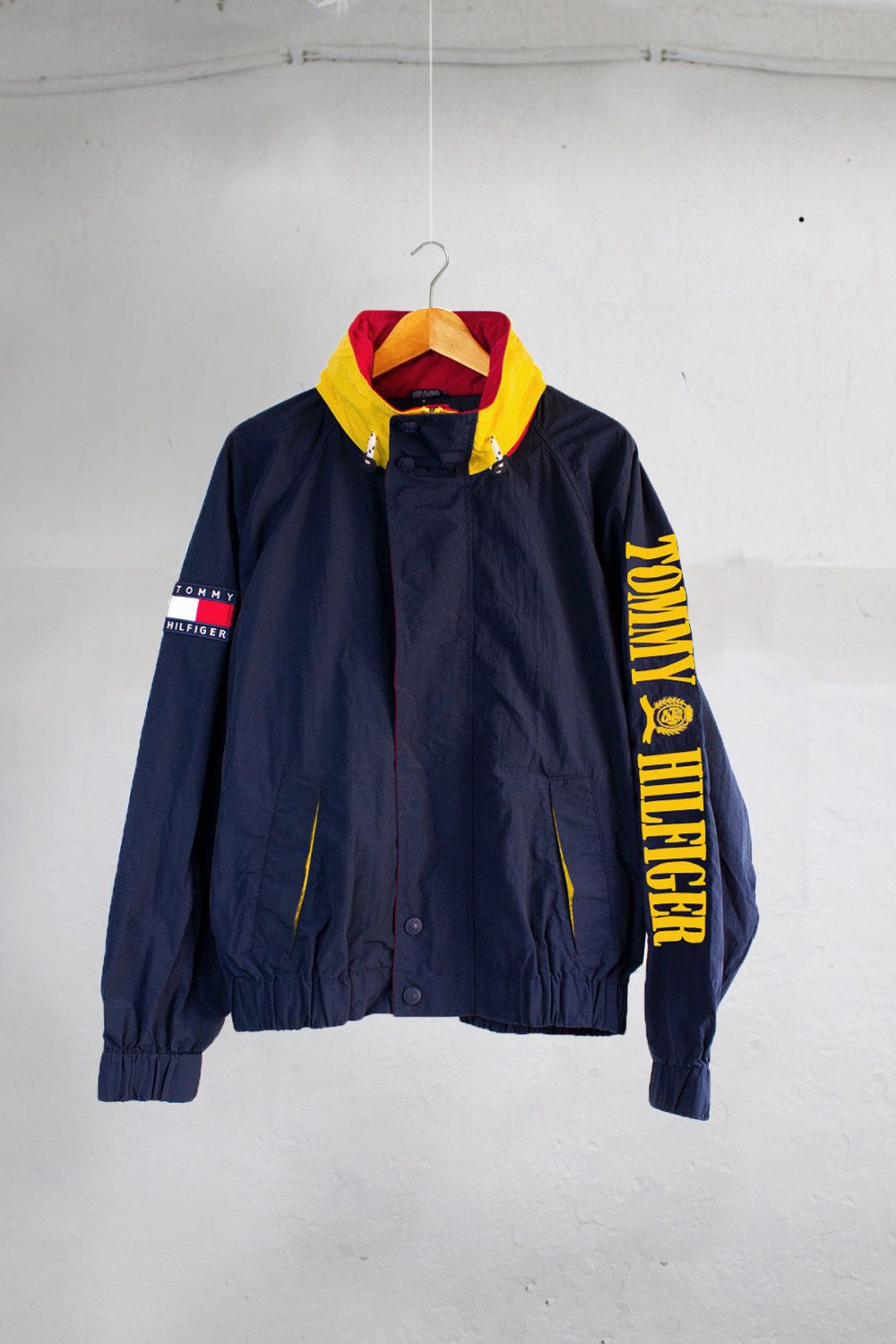 610b4b5125d4 Vintage 90 s Tommy Hilfiger Spell Out Navy Blue Red Yellow Hooded Jacket  Size L…